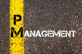 Concept image of Business Acronym PM as PROJECT MANAGEMENT written over road marking yellow paint line.